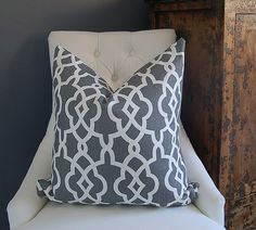 Great print on that pillow!  I really like it in contrast with the white chair and the distressed chest.