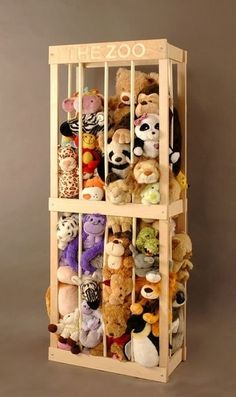 Toy storage-- Wooden frame but, I'd use bungee chords for the bars instead of wood-