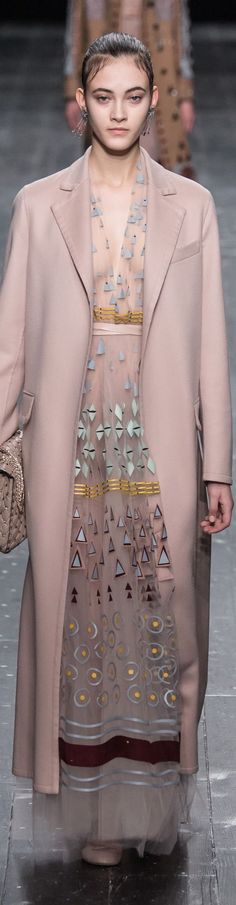 Valentino fall 2016 RTW menswear topper coat w feminine nude sheer appliqué dress. How to wear nudes and semi  monochromatic looks / dashes of blues, teals, rust w mostly one color unifying.