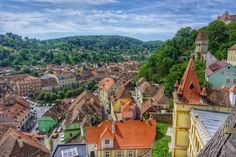 The citadel of Sighisoara Romania takes you into a medieval fairytale. A UNESCO World Heritage site & a must while traveling in Transylvania! 12th Century, World Heritage Sites, Paris Skyline, Fairy Tales, Cabin, House Styles, Day, Travel, Villas