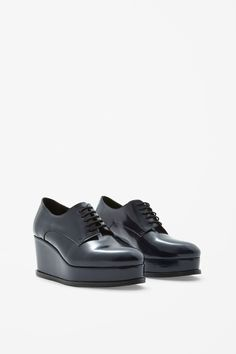 Based on the shape of a brogue, these lace-up shoes are updated with a chunky platform sole. A round-toe style, they are made from smooth, shiny leather and have a soft leather insole for comfort.