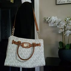 Michael Kors purse It's gorgeous!  Used just a couple times then stored. A very small blur blemish on bottom of purse see last pic on top left barely noticeable I haven't tried to clean yet.  Great price for this beauty paid full price at store.  Sorry no trades, priced to sell. Michael Kors Bags Satchels