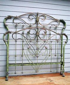 """Very unusual design w/ ying and yang of a  interior """"heart"""" design ..... yet with French curve """"dragon"""" castings. circa early 1800's #ironbeds #antiqueironbeds"""