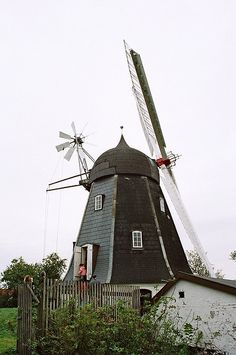 """An old windmill"" by fredesorensen on Flickr - The photographer stated that they call call it a 'Dutch Windmill' referring to the construction with the turning 'hat' (Done with the small windmill).  Aalborg SO, Aalborg, Nordjylland, Denmark"