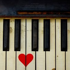 piano with a sweet little painted heart