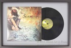 Of course you can frame a record! Here we have displayed the LP, partially in the cover, on a neutral grey mat with a black frame. We use special attachments to mount records without using adhesive. This is a signed album by Shel Silverstein.
