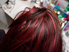 awesome highlights for dark hair | red hair strands combine with darker shades of red in this freshly ...