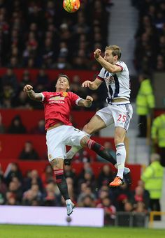 Marcos Rojo of Manchester United in action with Craig Dawson of West Bromwich Albion during the Barclays Premier League match between Manchester...