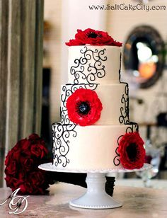 Black Scroll Work & Red Flowers Wedding Cake