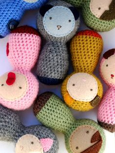 Crochet baby rattles.  Great simplicity and interesting faces.