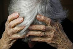 Elderly woman face-to-face with two burglars