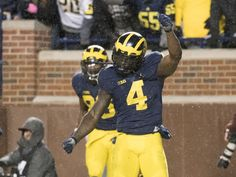 Michigan running back De'Veon Smith celebrates after