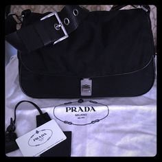 Prada handbag Lambskin Prada handbag. In great condition. Comes with all original certificates and dust bag. Lambskin strap has some wear but can be fixed. Smoke free home. Prada Bags Shoulder Bags