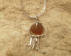 Small sterling silver jellyfish necklace with Lake Michigan beach glass.