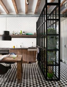 There's no need to be too plain when it comes to a tiled floor but if you go the busy route, scale back the colours and materials in your kitchen.