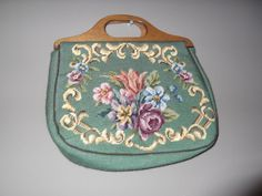 Vintage 40s Purse / 40s Vintage wood handle purse / Knit TAPESTRY Bag / Bold Floral Clutch. $39.00, via Etsy.