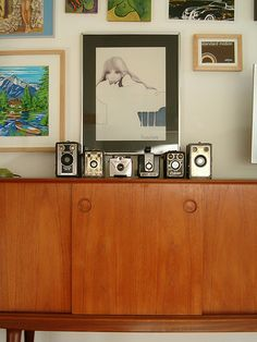 vintage cameras, a great credenza & lots of art