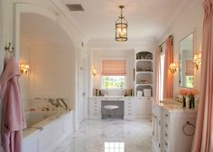 bathrooms - pink roman shade pinch-pleat pink silk drapes built-in white vanity marble top built-ins white single bathroom vanity marble countertop marble tiles floor arched tub nook
