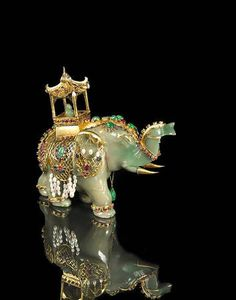 A jadeite jade and gem-set elephant. photo Bonhams the jadeite jade elephant with a carved emerald figure riding in a gold howdah,. Elephant Parade, Elephant Love, Elephant Art, Le Jade, Perfumes Vintage, Chinoiserie, Jade Jewelry, Objet D'art, Cultured Pearls