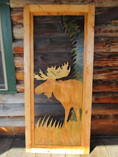 This Lodge Style screen door features a hand carved Moose with 3-D antlers on a Grassy Field.