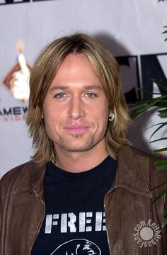 Keith Urban  Love him. Beautiful voice, amazing musician and dang handsome