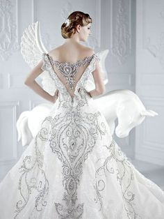 At first I thought the wing on the horse was a part of the wedding dress.  Love the back of this bride's dress.