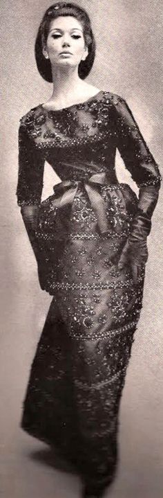 1960 Black organzine encrusted with glittering jet and midnight blue embroidery enveloping the figure in Givenchy opulence.