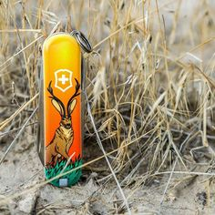 This Blade HQ Exclusive Victorinox Classic SD model has an orange handle with a majestic Jackalope on one side and the Blade HQ logo on the other. Victorinox Swiss Army, Carry On Suitcase, Swiss Army Knife, Tool Design, Dead Pool, Classic, Venom, Iron Man, Knives