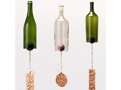 These wine bottle bell chimes were made using a hemp string, a wooden ball and a piece of hammered copper, but you could improvise any number of materials to come up with a similar result on your own. Just use the glass cutting kit from the beer bottle drinking glasses tutorial to slice off the bottom of the bottle. A wood or metal ring inside the bottle neck holds the string in place.