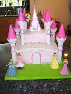 STA70715.JPG - This was my first castle cake. It was for my daughters 3rd Birthday. I used the Wilton Castle kit. Chocolate cake, buttercream frosting and royal icing flowers.