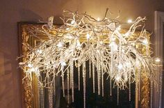 Branches with White Lights and Icicles over a mirror, doorway or on the mantel. no link for instruction but seems pretty simple.  #Christmas