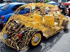 PUNCHBUGGY YELLOW.... wrought iron... OH, I don't even know how to CALL this one - no punchbacks!!!