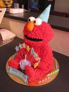 This is the cake i made for my daughters 1st birthday on the weekend. Elmo's body is cake and the head, arms and legs are RKT. The whole thing is covered in buttercream. Had alot of fun making this cake.