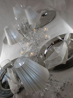 """kinda neat table scape with wine glasses with velum shades, chargers and """"confetti"""".  Save On Crafts"""