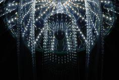 Skyphos 1 chandelier by Prague-based artist Kateřina Smolíková: a jellyfish-like web of blown glass tubing threaded with strips of LEDs.
