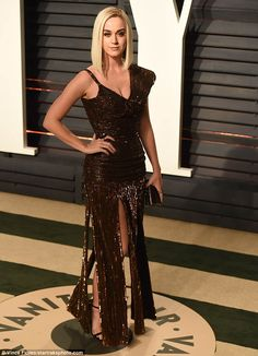 Luscious locks: The California-born beautystyled her platinum blonde tresses in a shoulde...