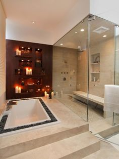 Love the red wall with built in shelves and the rocks around the tub