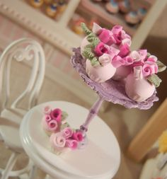 Dollhouse Miniature Shabby Chic Style Cupcakes Garnished with Roses in Shades of Lilac  - 1/12th scale. $13.50, via Etsy.