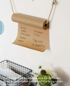 Roll of Kraft Note Paper Hanging from the Wall with twine and eye hooks
