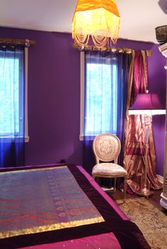 Bohemian Style bedroom designed by Jane Hall Design with custom made bedding and lampshades and a painted armoire