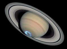 The UV image of the southern polar region of Saturn w/its aurora was taken on 1/28/2004 by Hubble
