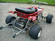 Customized, motorized Radio Flyer with wheelie bars 'n wings 'n all. Every kids dream wagon...