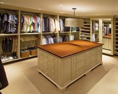 Master Closet Design. Love the large open space with lots of storage.