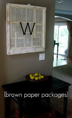 Monogrammed window with old book pages