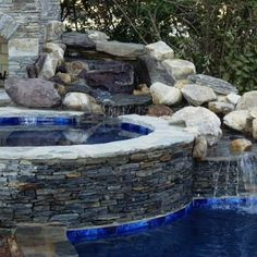 This majestic pool and spa area is made with Augusta natural thin stone veneer from the Quarry Mill #naturalstone #stoneveneer #thinstone #realstone #quarry #freeshipping #madeinamerica #poolandspa #retreat #waterfall #outdoorliving #dreamhouse #pool #architecturelovers #designinspiration #designideas #architecture #stonesiding #quarrymill #inspired by nature #waterfall Thin Stone Veneer, Natural Stone Veneer, Natural Stones, Backyard Pool Designs, Swimming Pools Backyard, Patio Design, House Design, Hot Tub Surround, Outdoor Stone