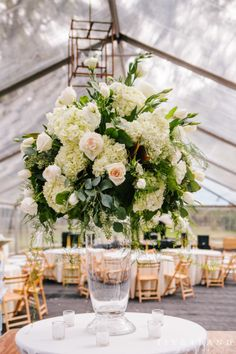 Think about a beautiful winter white centerpiece that is the focus of the room for your reception space. Photo taken at the Legare Waring House.