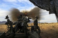 Army Spc. Macmillan Ekedede fires a round downrange during Exercise Iron Strike on Fort Bliss, Texas, Dec. 8, 2014. Ekedede, an assistant gunner, is assigned to Battery A, 2nd Battalion, 3rd Field Artillery Regiment, 1st Armored Division Artillery.hires_141208-A-ZU617-387B.jpg (1800×1200)