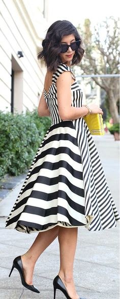 I'm not sure how I feel about the dress itself; but I am mesmerized by the black and white stripes...