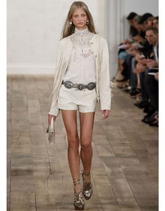 Ralph Lauren does western. Silk shorts, prairie lace shirt and fringed leather jacket. I love this look.