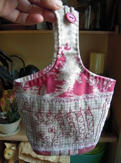 peg bag with button closure                                                                                                                                                                                 More